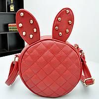 Красная стильная женская сумка с ушами и  шипами