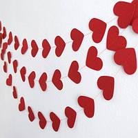 Бумажная гирлянда из сердечек красная