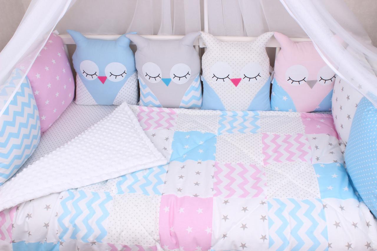 Комплект в кроватку с зверюшками в розово-голубых тонах