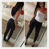 Женские брюки из трикотажа в черном цвете и в клетку  572159