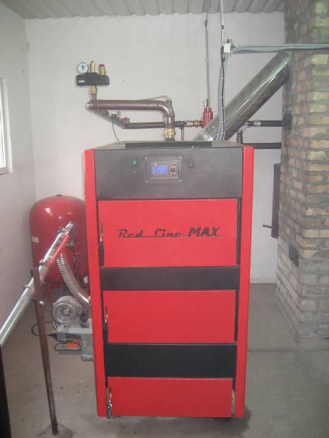 Пеллетный котел RED LINE MAX 75 кВт с Пеллетной горелкой ECO -PALNIC UNI MAX 70 кВт. Отапливает производственное здание 800 м.кв компании ТОВ СТЕКЛОПЛАСТИК, г. Бердянск.