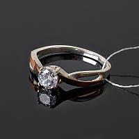 Серебряное кольцо с золотыми вставками и камнем