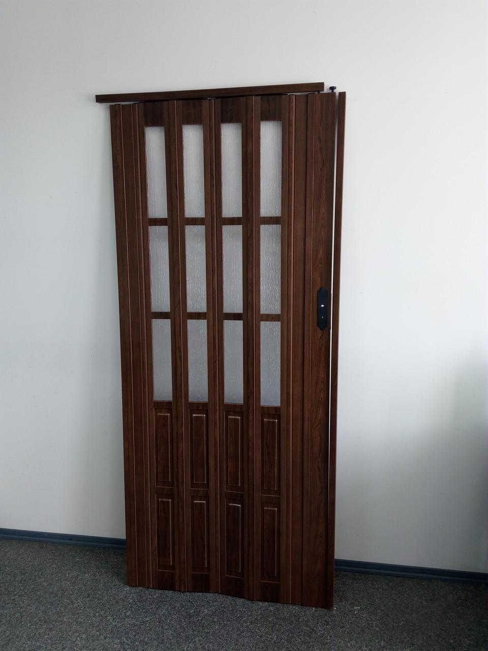 Межкомнатная дверь гармошка 860х2030х12мм полу остекленные  дуб темный 7036