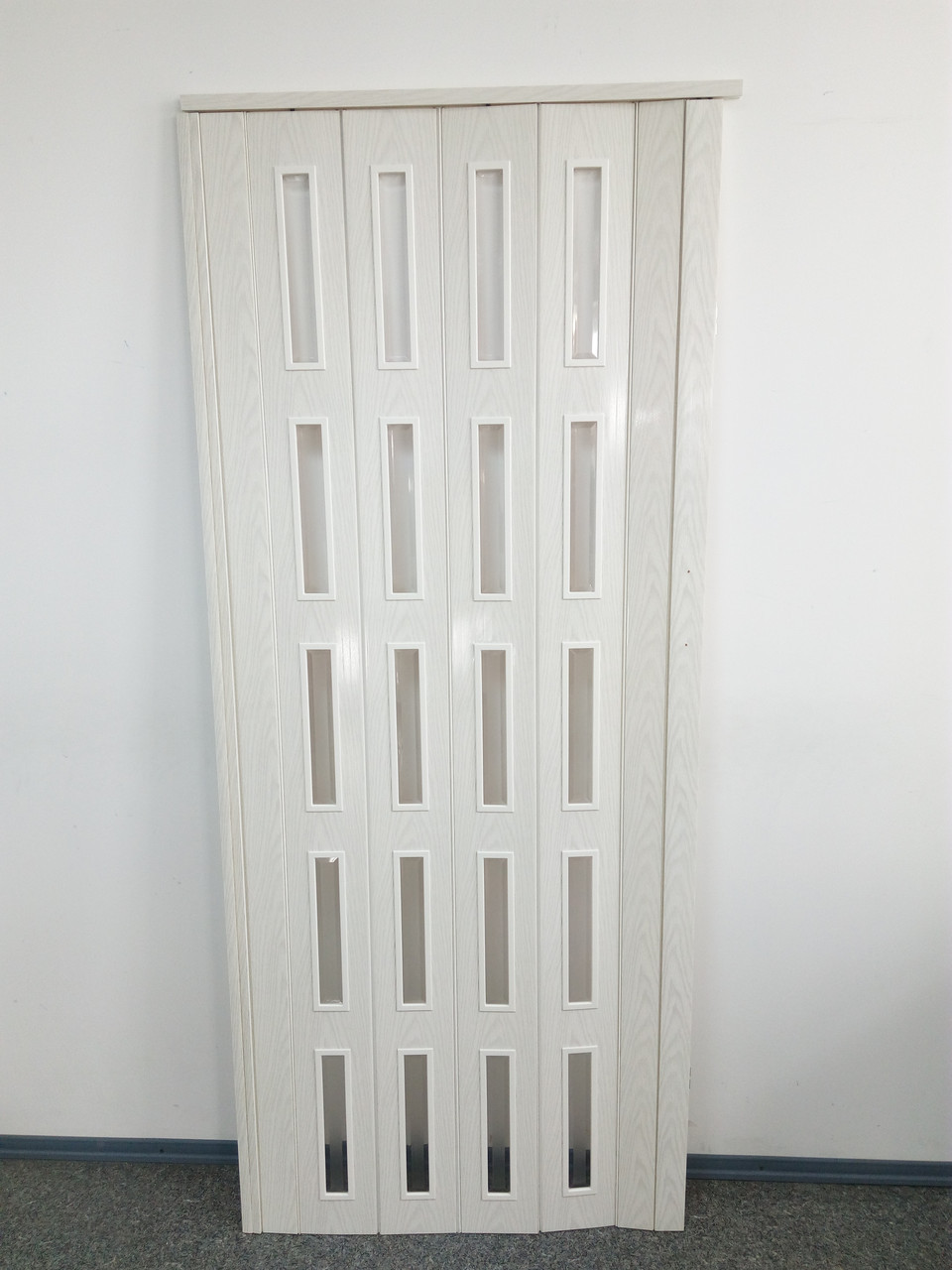 Двери-гармошка 860х2030х6мм  ольха белая  остекленная 7202 раздвижная