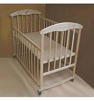 Дитяче ліжечко БЕЗ ЛАКУ з ясена, боковина ОПУСКАЄТЬСЯ