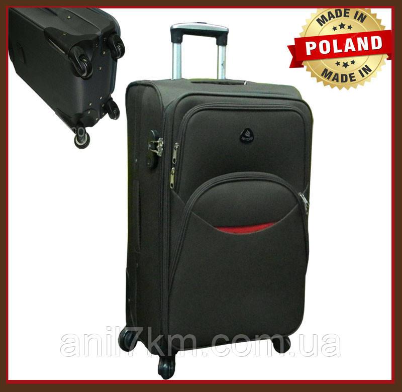 Середній дорожній валізу на чотирьох колесах
