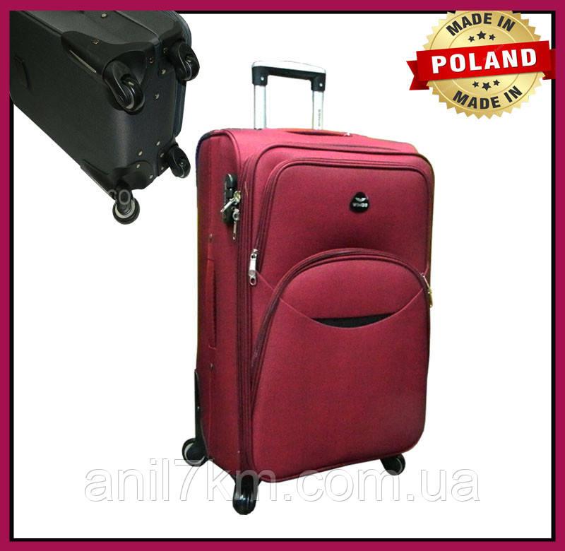 Малий дорожній валізу на чотирьох колесах