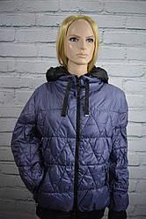 Куртка-пуховик женския зимняя
