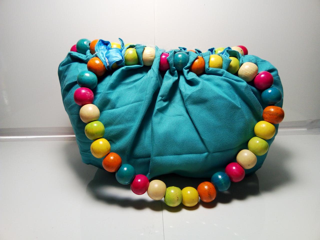 Женская бирюзовая сумочка «Бусы»