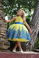 Сукня жовто-блакитна з ажуром і бантом ззаду на поясі. Розміри від року до 10р..