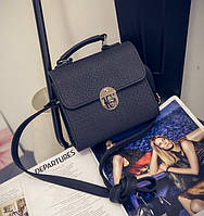 Женская маленькая сумочка на металлической заклепке черная