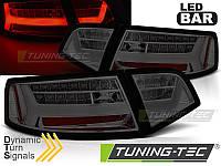 Оптика задняя, фонари светодиодные AUDI A6 (LED BAR) SEDAN тонированные