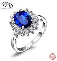Серебряное кольцо с сапфиром и цирконием  1dd99e549327d