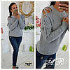 Женский вязаный свитер со шнуровкой