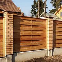 Плетенный забор из массива сосны