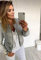 Женская короткая куртка с горизонтальными кармашками на молнии