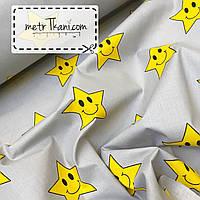 """Ткань хлопок """"Смайлы"""" желтые звезды  на сером фоне №680"""