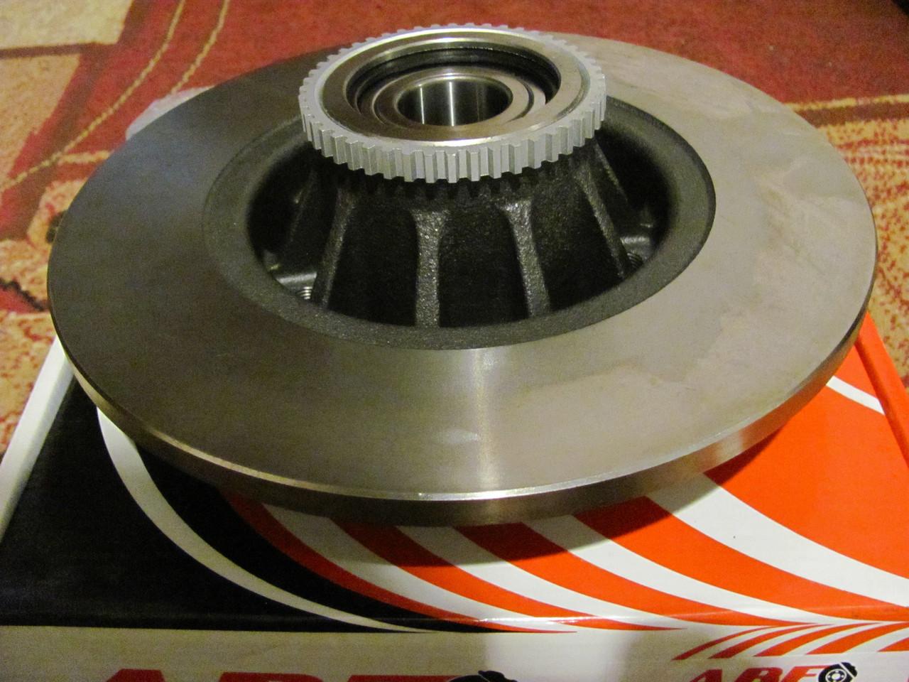 Тормозной диск Nissan Primastar, Opel Vivaro, Renault Trafic ll задній з підщипником