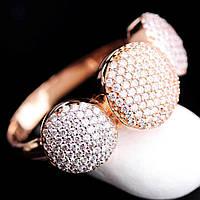 Женское кольцо из белого и красного золота с фианитами