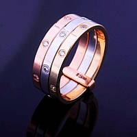 Тройное женское кольцо из белого, красного и желтого золота с фианитами