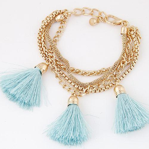 Браслет золотые цепочки с голубыми кисточками B005475