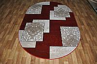 Рельефный полипропиленовый ковер Meral 1682 бордовый овальный