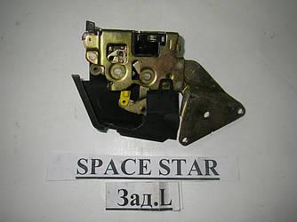 Замок двери задний левый электр Mitsubishi Space Star 98-05 (Мицубиси Спейс Стар)  MR911785