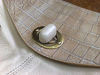 Ремонт поворотного замка на сумке