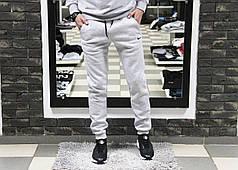 Мужские спортивные штаны Найк Nike светло-серые с манжетами (реплика) на флисе