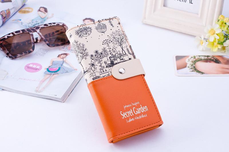 Оранжевый женский кошелек на кнопке Secret Garden