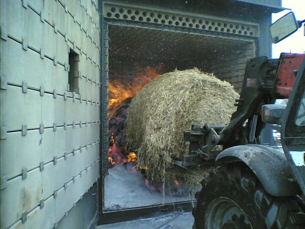 Управление твердотопливным котлом отопления фермы.