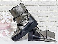 Зимние высокие ботиночки Луноходы в стиле Moon Boot из натуральной кожи черного и платинового цвета, на прорезиненной утолщенной подошве, Коллекция