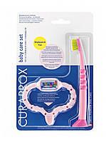 Стимулятор для прорезывания розовый и детская зубная щетка Curaprox CKC 42 girl