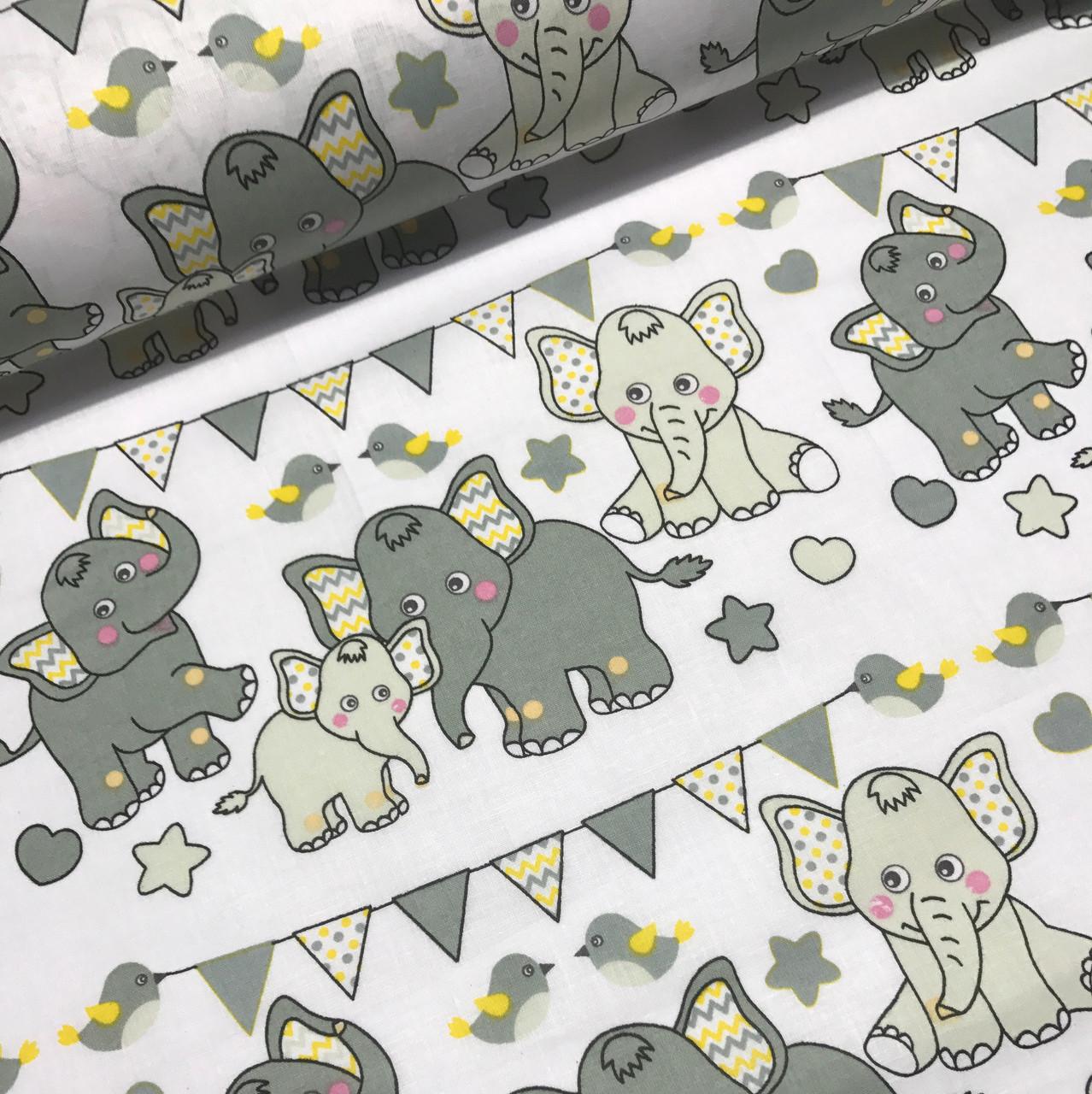 Хлопковая ткань польская слоники с треугольными флажками серо-желтые №171