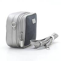 Женская маленькая серебристая сумка с молниями