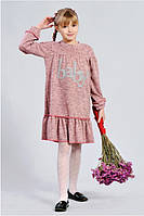 Модное платье из трикотажа .украшено камнями
