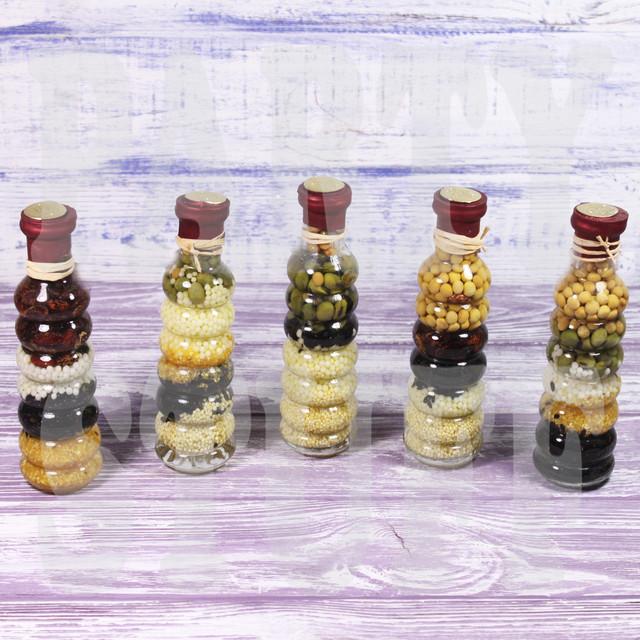 Декоративная бутылка с зернами