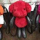 Меховой рюкзак разных цветов.