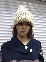 Женская зимняя шапка крупной вязки бежевого цвета