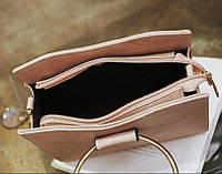 Женская сумка из кожзама с ручкой-кольцом и меховым брелком
