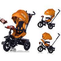 Детский трехколесный велосипед с поворотным сиденьем Tilly cayman T-381, оранжевый