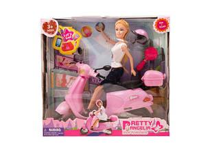 Кукла типа Барби на мотоцикле