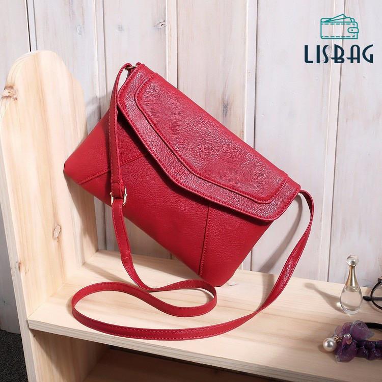 Маленькая женская сумка через плечо красного цвета
