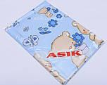 Простынь в детскую кроватку «Мишка с цветочком» голубого цвета (120*60)