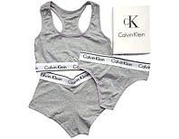 Женский комплект нижнего белья серый  Calvin Klein (топ + стринги+шорты)