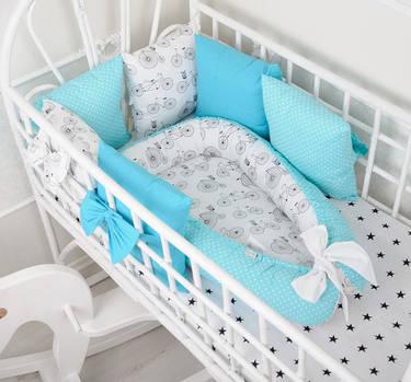 Чи потрібні бортики в ліжечко малюка?