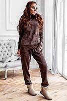 Женский вязаный костюм: свитер и штаны