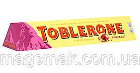 Шоколад Toblerone Молочний з родзинками і нугою 100 г