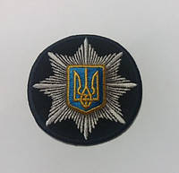 Кокарда национальной полиции Украина