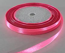 Лента атласная. Цвет - ярко-розовый. Ширина - 0,7см, длина - 23 м